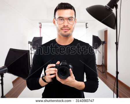stock-photo-portrait-of-a-professional-photographer-in-his-studio-314090747